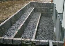 Mauern Palisaden Boeschungssicherung Granit Lichtschachtboeschung