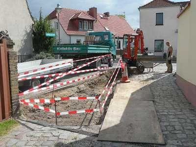 Pflasterarbeiten Naturstein Einfahrt mit Grosssteinpflaster