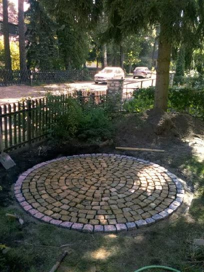 Pflasterarbeiten Naturstein Pflasterkreis aus Granitpflaster